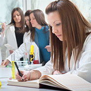 Students Study in Lab Coats