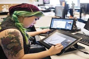 Game designer working on tablet